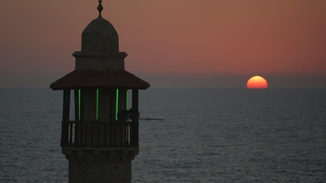 ms shot of sun set on mediterranean sea with al bahr mosque tower / jaffa, tel, aviv israel - jaffa stock videos & royalty-free footage