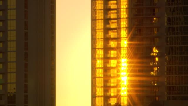 MS Shot of Sun shining through sky scraper/ Las Vegas, Nevada, United States