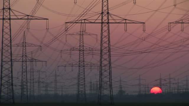 ms shot of sunset / niederaubem, north rhine- westphalia, germany - power line stock-videos und b-roll-filmmaterial