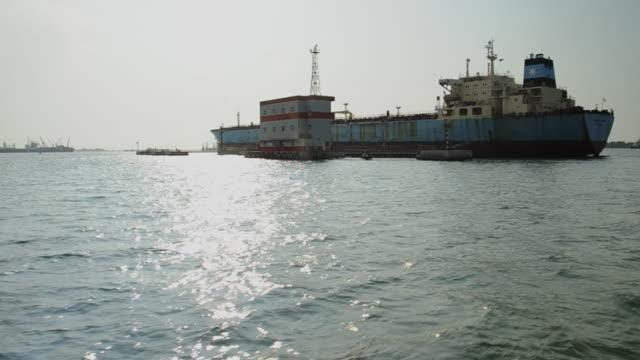 MS POV Shot of supply boat travelling alongside offshore oil berth / Luanda, Angola