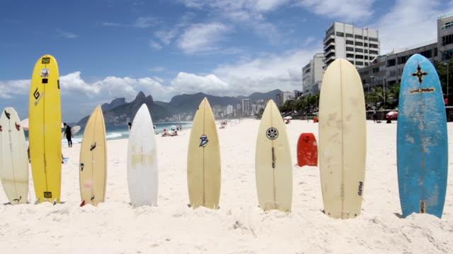 Shot of surfboards standing in a row on Ipanema beach, Rio de Janeiro.