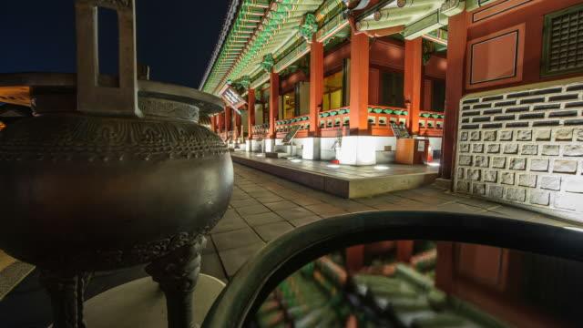 ms t/l pan shot of suwon hwaseong castes bongsudang building at night (unesco heritage) / suwon, kyonggi-do province, south korea   - suwon stock videos and b-roll footage