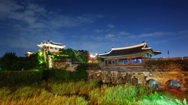 ms t/l shot of suwon hwaseong castles banghwasuryujeong building at night (unesco heritage) / suwon, kyonggi-do province, south korea   - kyonggi do province stock videos and b-roll footage