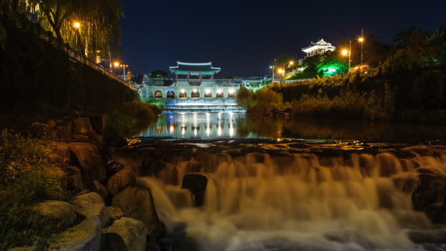 ms t/l shot of suwon hwaseong castles hwahongmun gate building at night (unesco heritage) / suwon, kyonggi-do province, south korea   - kyonggi do province stock videos and b-roll footage