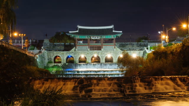 ms t/l shot of suwon hwaseong castle's hwahongmun gate building at night (unesco heritage) / suwon, kyonggi-do province, south korea   - kyonggi do province stock videos and b-roll footage