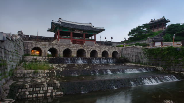 ms t/l shot of suwon hwaseong castles hwahongmun gate building at sunset (unesco heritage) / suwon, kyonggi-do province, south korea   - kyonggi do province stock videos and b-roll footage