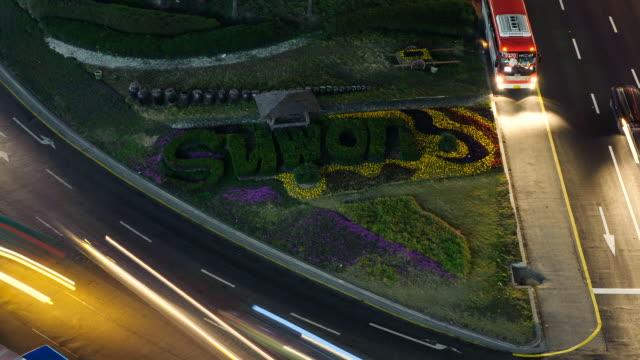 ms t/l shot of suwon symbolic slogan in traffic circle near suwon station area / suwon, gyeonggi-do, south korea  - suwon stock videos and b-roll footage