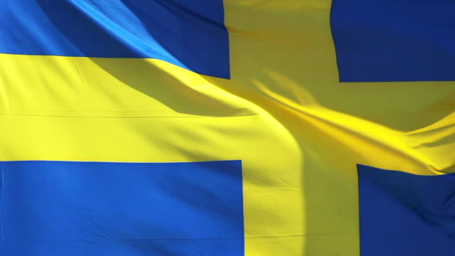 cu slo mo shot of sweden flag waving in wind / caen, normandy, france - swedish flag stock videos and b-roll footage