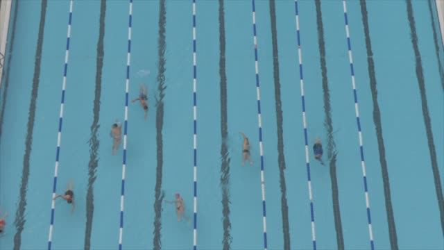 shot of swimmers from elevated position, gordon pool, tel aviv, israel, middle east - 室外プール点の映像素材/bロール