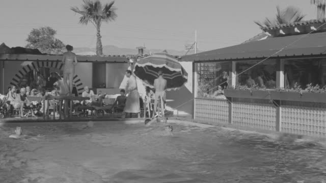 MS Shot of swimming pool with people in water in Palm Springs