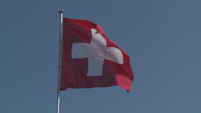 cu shot of swiss flag / zurich, switzerland   - national flag stock videos & royalty-free footage
