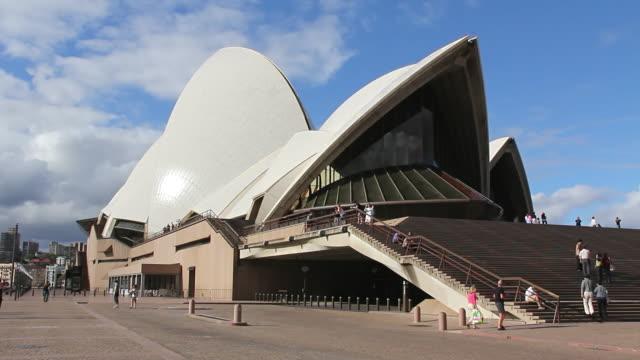 MS Shot of  Sydney Opera house with people walking in area / Sydney, Australia