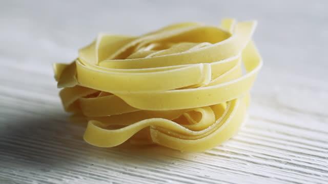 cu pan shot of tagliatelle pasta / london, united kingdom  - tagliatelle stock videos and b-roll footage