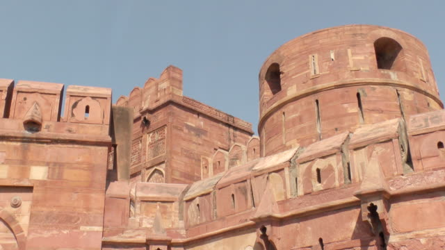 ms shot of taj mahal building against blue sky / agra, uttar pradesh, india  - agra video stock e b–roll