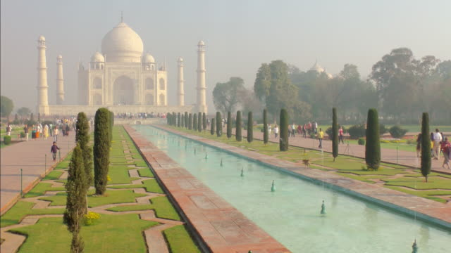 ms shot of taj mahal reflecting pool and gardens / agra, uttar pradesh, india - taj mahal stock videos and b-roll footage