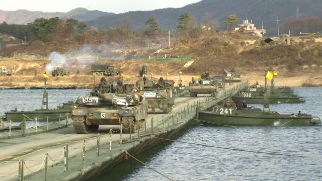 Shot of tanks moving for military exercise