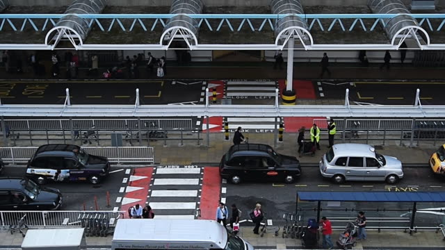 ms ha t/l shot of taxi rank at heathrow airport / london, united kingdom  - heathrow airport stock videos and b-roll footage