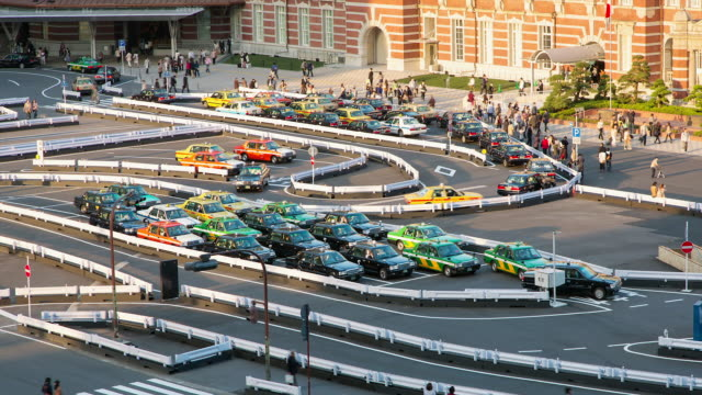 MS T/L Shot of taxis waiting for customers at Tokyo station / Tokyo, Japan