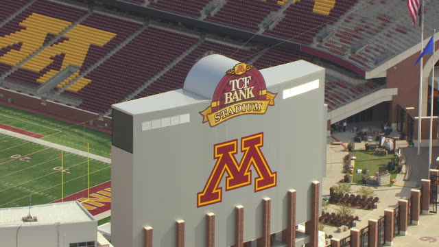 CU AERIAL ZO Shot of TCF Bank Stadium signage and reveal all of stadium / Minneapolis, Minnesota, United States