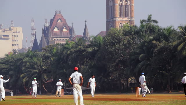 WS Shot of Team of cricketers playing cricket match on Oval Maidan / Mumbai, India