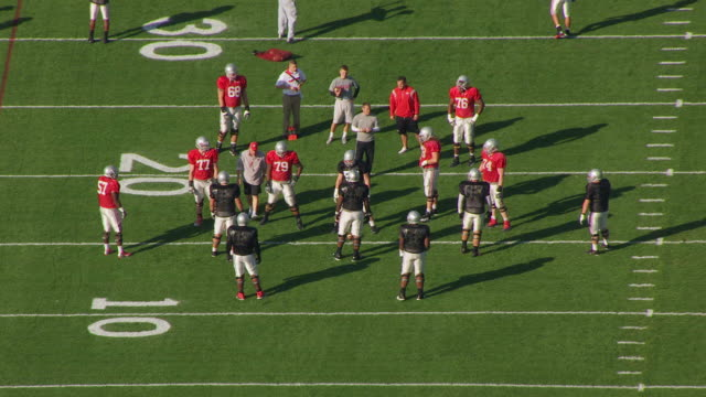 ms zo aerial shot of teammates on field during practice at football practice fields at ohio state university / columbus, ohio, united states - ohio state university stock videos & royalty-free footage