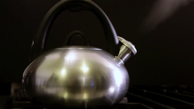 ECU Shot of Teapot steaming at home / Los Angeles, California, United States