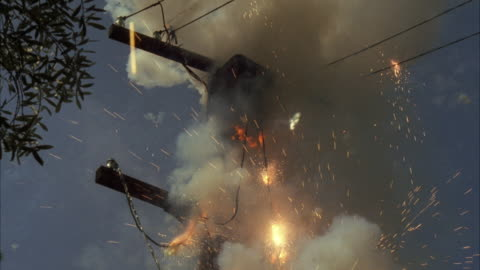 ms tu zo shot of telephone pole with transformer being exploded / los angeles, california, united  - sparks stock-videos und b-roll-filmmaterial