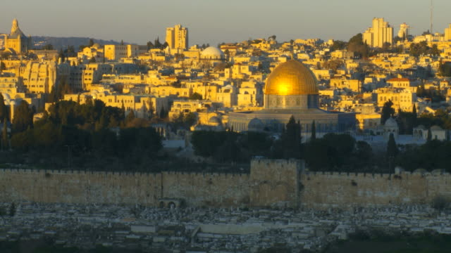 MS T/L Shot of Temple Mount unveiling with golden light from Mt. of olives with old city / Jerusalem, Judea, Israel
