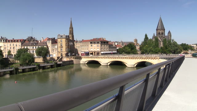 ms shot of temple neuf and moyen pont on moselle river / metz, lorraine, france - lorraine stock-videos und b-roll-filmmaterial