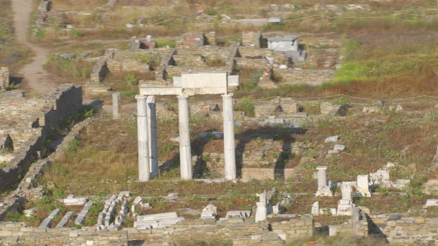 MS AERIAL ZO Shot of temple ruin of delos / Delos, Cyclades, Greece