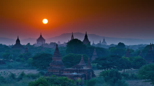 ws t/l shot of temples at sunset time / bagan, mandalay region, myanmar - myanmar stock videos and b-roll footage