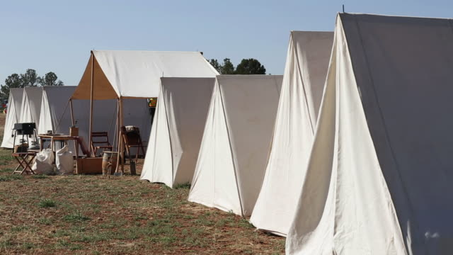 ms pan shot of tents from civil war reinactment / santa fe, new mexico, united states - historische nachstellung stock-videos und b-roll-filmmaterial