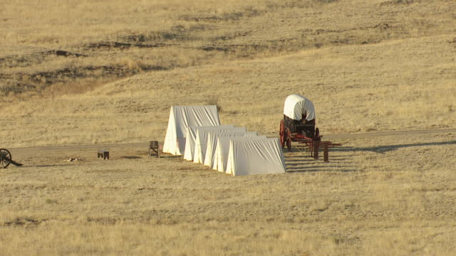 ms aerial shot of tents with carriage in field at fort union national monument in mora county / new mexico, united states - new mexico stock videos & royalty-free footage