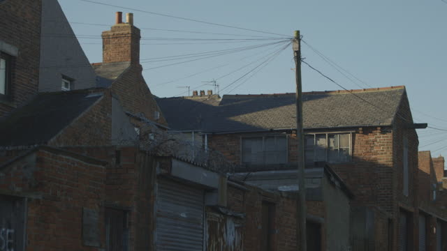 ms shot of terraced house / north of england, united kingdom - housing difficulties stock videos & royalty-free footage