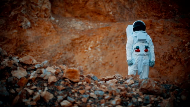 shot of the astronaut wearing space suit exploring mars/ red planet. first manned mission to mars, technological advance brings space exploration, colonization - spaceship stock videos & royalty-free footage