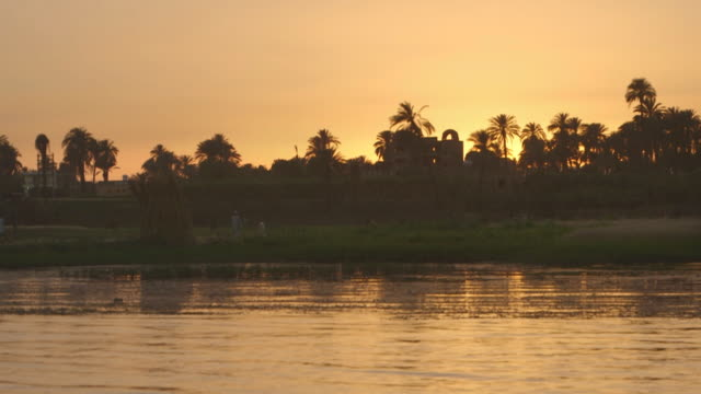 pov shot of the banks of the river nile at sunset, egypt. - riverbank stock videos & royalty-free footage