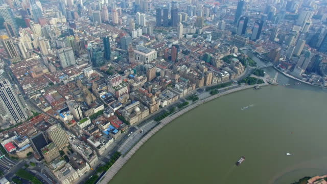 aerial shot of the bund of huangpo river and cityscape/shanghai,china - conceptual symbol stock videos and b-roll footage