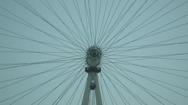 shot of the central axis of the london eye as it slowly turns. - wheel stock videos and b-roll footage