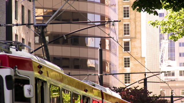 stockvideo's en b-roll-footage met shot of the city tram electric lines as a tram comes to a stop. - trambaan
