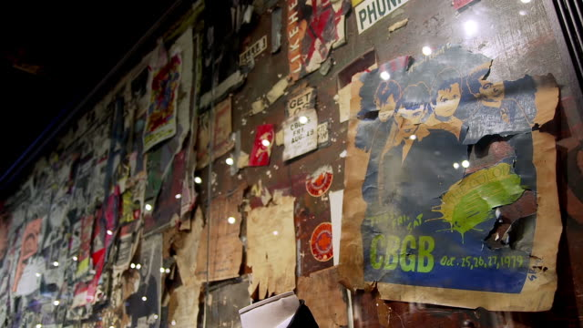 ms shot of the colors music band and other cbgb club performance posters cover the wall of present day john varvatos store in the bowery neighborhood of manhattan / new york, united states - music poster stock videos & royalty-free footage
