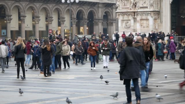 shot of the crowd taking photos and walking in front of the piazza del duomo in milan italy - piazza del duomo milan stock videos and b-roll footage