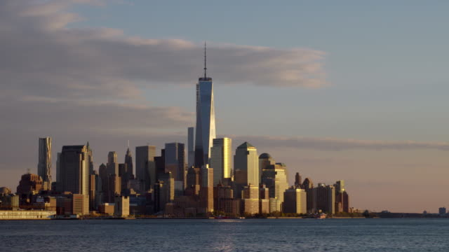 Shot of the Downtown Manhattan Skyline from across the Hudson River with One World Trade Center in the middle of the shot.