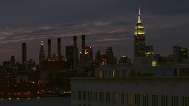 Shot of the Empire State Building and the Manhattan Skyline from across the East River