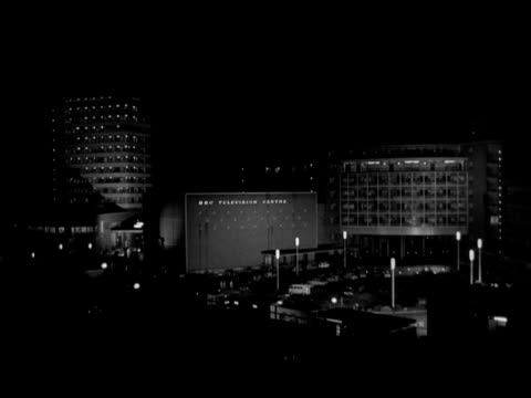 vidéos et rushes de shot of the exterior of bbc television centre at night; 1965. - bbc