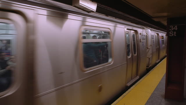 Shot of the F train pulling away from the platform at the 34th Street Station.
