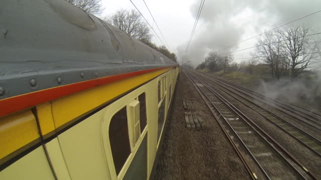 Shot of The Flying Scotsman travelling along a train track from a camera mounted on the side of the carriage