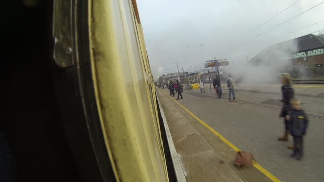 Shot of The Flying Scotsman travelling through Hatfield train station from a camera mounted on the side of the carriage