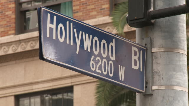 vidéos et rushes de shot of the hollywood blvd sign at the 6200 w block in los angeles  - hollywood boulevard