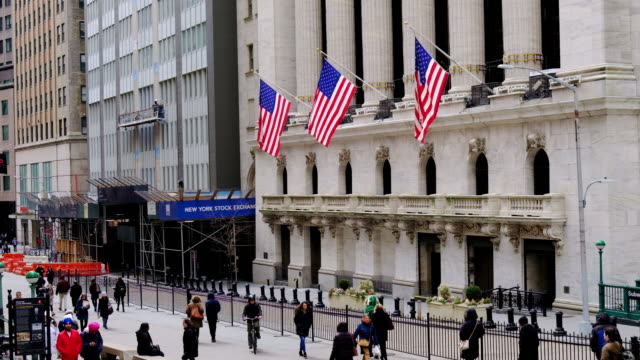 shot of the new york stock exchange on wall street in winter. - new york stock exchange stock videos & royalty-free footage