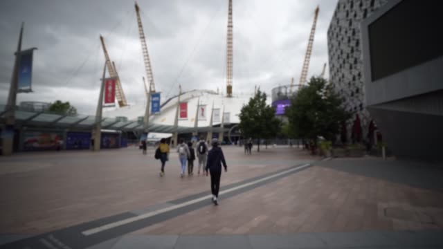 steadicam shot of the o2 arena as parts of it open after lockdown restriction and lifted on july 15 2020 in london england during the coronavirus... - picking up stock videos & royalty-free footage